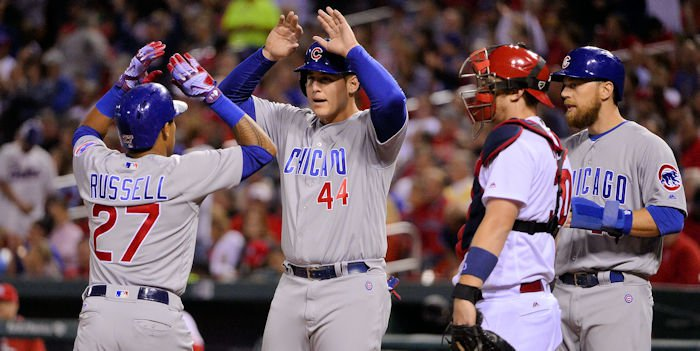 Cubs teammates celebrate after Russell's homer (Jeff Curry - USA Today Sports)