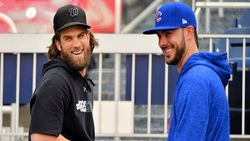 Latest news and rumors: CubsCon notes, KB on Harper/Machado, Cubs sign reliever, more