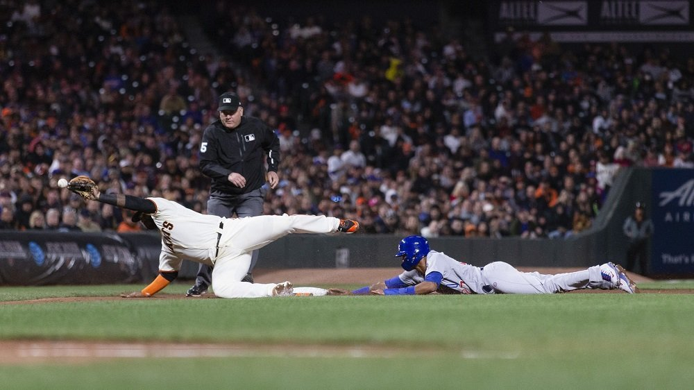 Addison Russell's winning run was scored due to a pair of San Francisco blunders. (Photo Credit: Neville E. Guard-USA TODAY Sports)