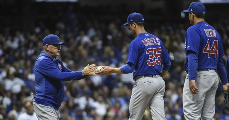 Chicago Cubs starting pitcher Cole Hamels did not remain in Friday's game for very long. (Credit: Benny Sieu-USA TODAY Sports)