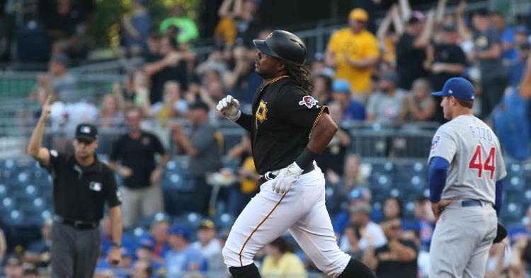 Josh Bell dominated Cubs pitching by going yard three times on the night. (Credit: Charles LeClaire-USA TODAY Sports)