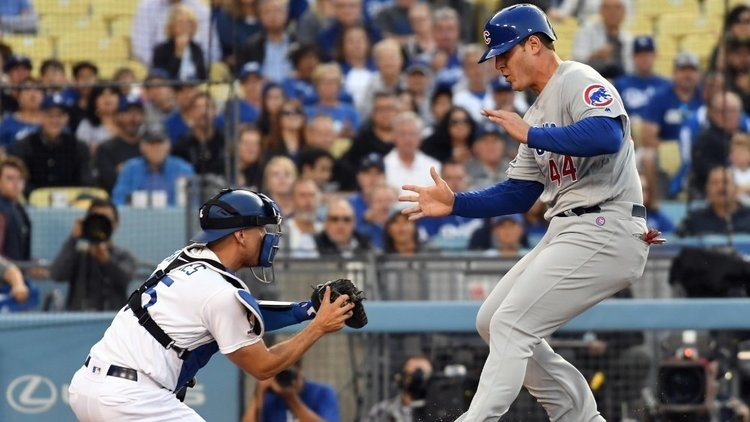 Anthony Rizzo was forced to make a futile attempt at stealing home after getting caught in a rundown. (Credit: Richard Mackson-USA TODAY Sports)