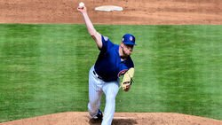 Cubs place reliever on IL, call up righty pitcher