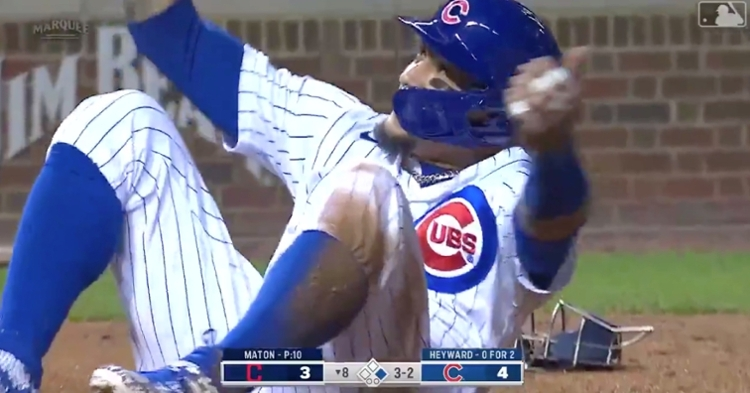 """Javier """"El Mago"""" Baez scurried from first base to home plate on a steal attempt that was aided by a throwing error."""