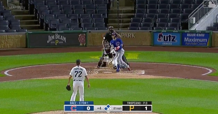 """Javier """"El Mago"""" Baez eyeballed his spectacular home run as it carried into the seats."""