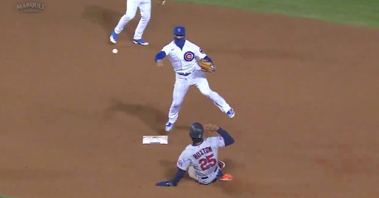Javier Baez hopped off second base and hurled a perfect throw to first base as part of a double play in the top of the ninth.