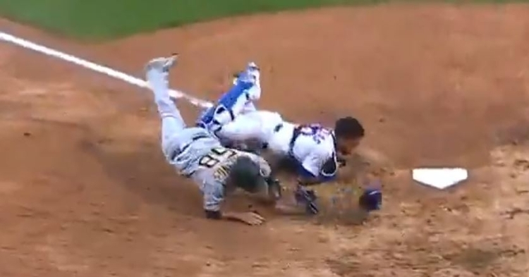 Jacob Stallings collided with Willson Contreras, who tagged Stallings out after receiving a throw from Kyle Schwarber.