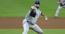Jon Lester pitches five innings of no-hit ball as Cubs stave off Reds