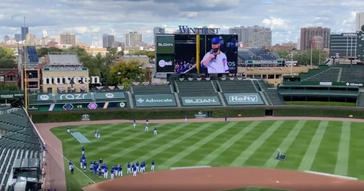 A Jon Lester tribute video narrated by Kyle Schwarber played on the Wrigley Field video board at a Cubs practice.