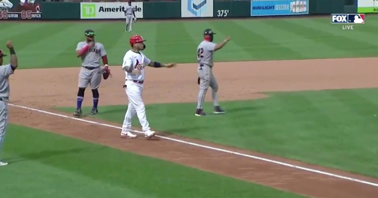 Yadier Molina was baffled after a chopper hit by Matt Carpenter was ruled fair, leading to a game-ending double play at Busch Stadium.