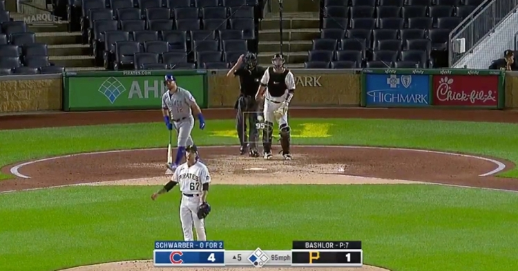 Cubs slugger Kyle Schwarber ogled his mammoth home run before heading to first base.