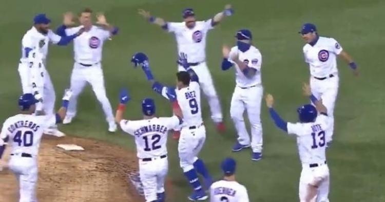 A socially distanced infield celebration followed Javier Baez's walkoff single.
