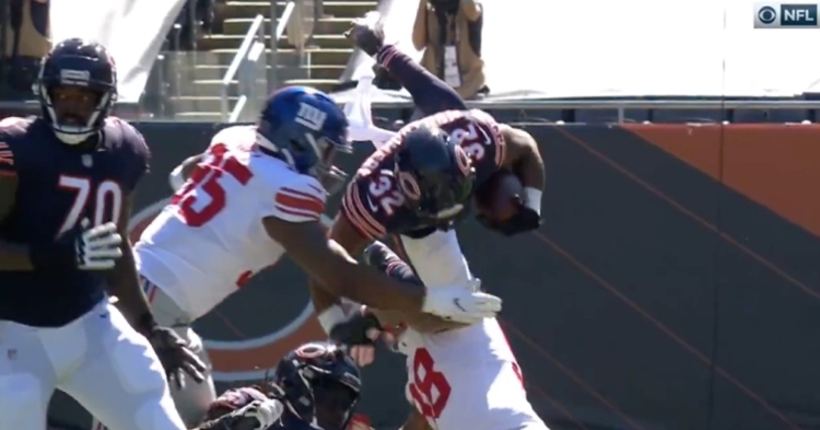 Bears running back David Montgomery's helmet collided with the ground after getting tripped up on a hurdle attempt.