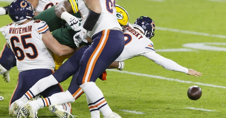 Mitchell Trubisky was picked off twice, and he coughed up a fumble that was run back for a Green Bay touchdown. (Credit: Jeff Hanisch-USA TODAY Sports)