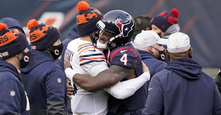 Trubisky and Watson embrace after the contest (Mike Dinovo - USA Today Sports)