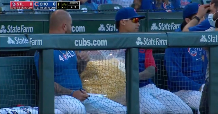 Javier Baez chowed down on popcorn while taking in Sunday's Cardinals-Cubs game.
