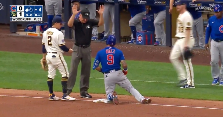 Javier Baez slid in safely at third base after hitting a line drive to the opposite field. He scored a game-tying run soon afterward.