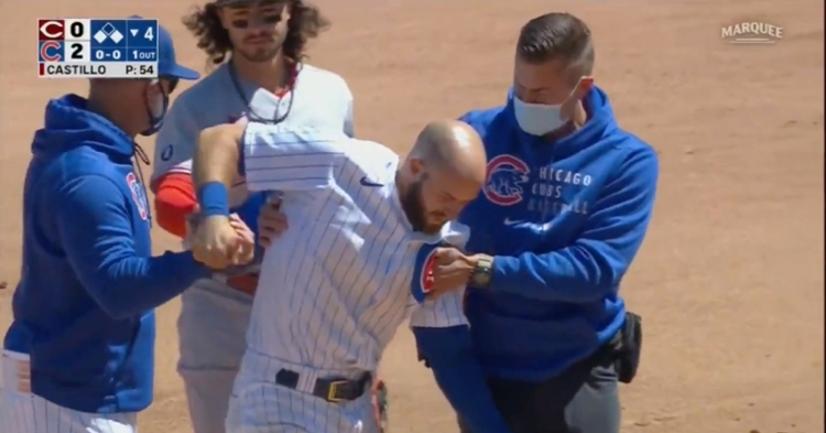 David Bote walked off the field in obvious pain after suffering an apparent left shoulder injury on a slide.