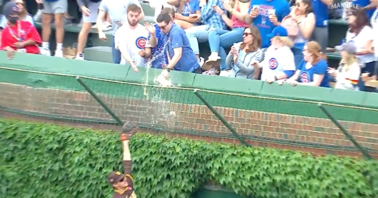 Was this fan planning to continue drinking the beer after a baseball landed in it? The world may never know.
