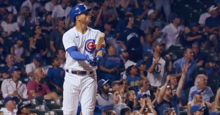 Willson Contreras watched his game-tying bomb carry into the bleachers and celebrated by tossing his bat over his head.