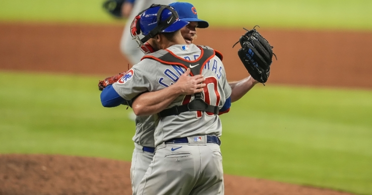 Contreras embraces Kimbrel after the win (Dale Zanine - USA Today Sports)