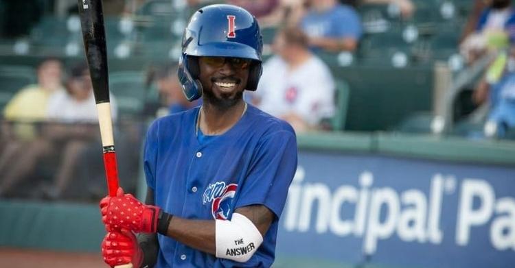 Dee Gordon smiling during ballgame (Photo via Iowa Cubs)