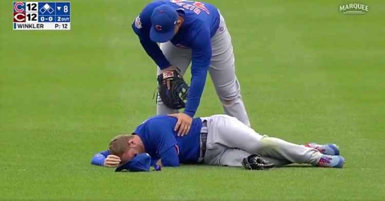 Ian Happ was in obvious pain after colliding with Nico Hoerner while pursuing a pop fly.