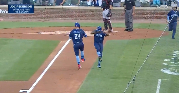 Joc Pederson and third-base coach Willie Harris celebrated Pederson's leadoff jack on the basepaths.