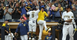 Brewers rally late against Cubs to clinch postseason berth