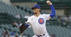 Cubs lose slugfest in extras